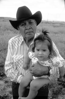 Native American man hoding grandaughter